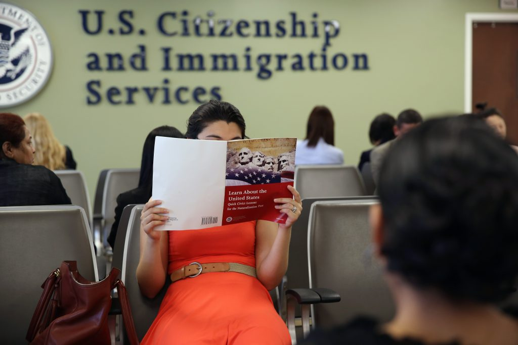 NEW YORK, NY - MAY 30:  A Colombian immigrant studies ahead of her citizenship exam at the U.S. Citizenship and Immigration Services (USCIS) Queens office on May 30, 2013 in the Long Island City neighborhood of the Queens borough of New York City. The branch office is located in an area heavily populated by immigrants and processes thousands of Green Card and U.S. citizenship applications each year.  (Photo by John Moore/Getty Images)